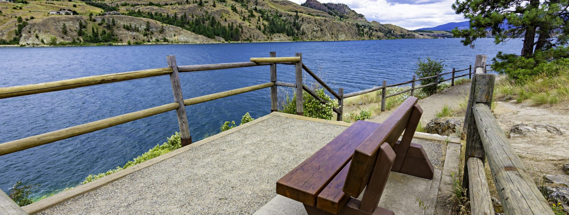 View of a park bench at Kalamalka Lake from Kalamalka Lake Provinial Park near Vernon British Columbia Canada